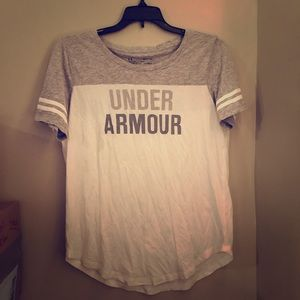 white and grey under armour tee shirt